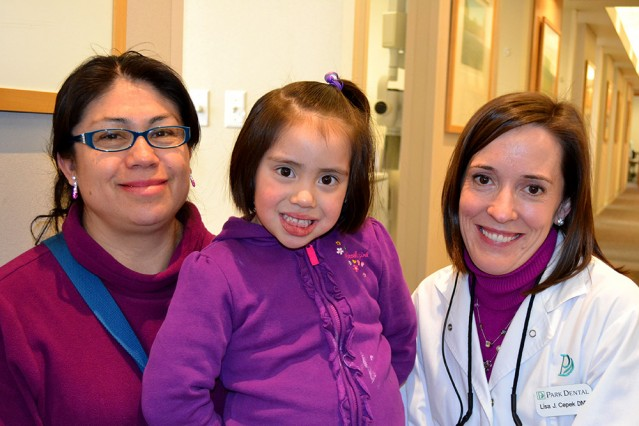 Give Kids a Smile Dentist with Patients