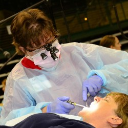 Dentist With Patient at Mission of Mercy